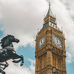Top half of Big Ben Elizabeth Tower in London with horse from statue of Queen Boudicca in foreground - Photo by Jurica Koletić on Unsplash