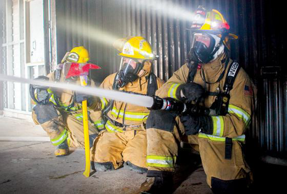 Mid-State Technical College students during a fire suppression exercise in the Fire Protection Technician associate degree program. The scene offers a preview of the hands-on preparation planned for students enrolling in the new Firefighter Technician Academy.