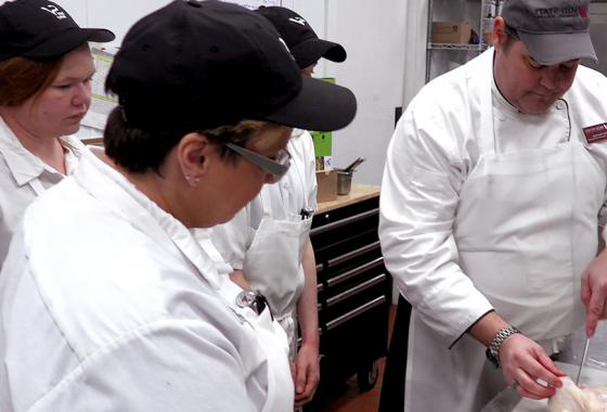 Hospitality Management Instructor Paul Kennedy demonstrates quartering a chicken to students in the free spring 2020 Sand Valley Culinary Training program. Students who complete the program earn a local certificate and a job interview for a professional culinary position with Sand Valley in addition to 10 college credits that can be applied to Mid-State's Hospitality Management associate degree program.